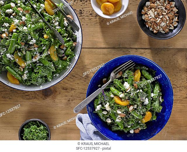 Kale and Sugar Snap Pea Salad with Dried Apricots and Crumbled Feta Cheese
