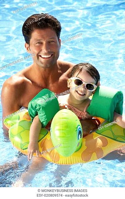 Father And Daughter Having Fun In Swimming Pool