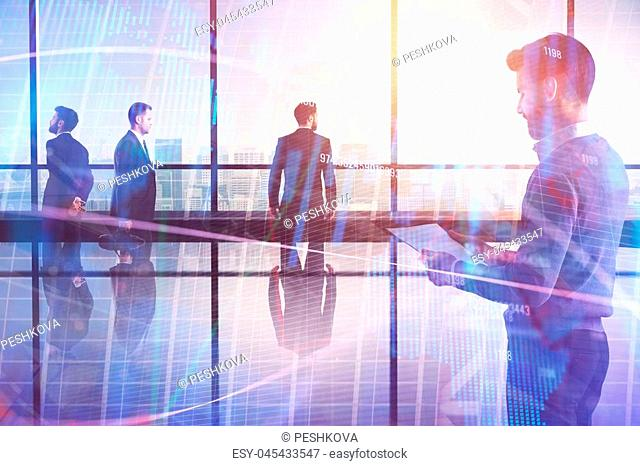 Meeting, investment, teamwork and workplace concept. Attractive young european businesspeople standing in modern office interior with forex chart and digital...