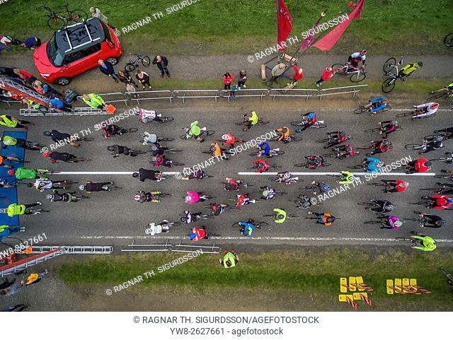 Top view of bicycle race by Lake Laugarvatn, Iceland. Bicycle race in the summer- image shot with a drone