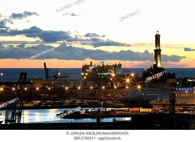 The Lighthouse of Genoa with cruise ship in the Porto Antico harbour, Genoa, Liguria, Italy