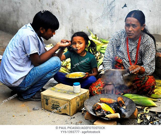 nepalese family selling corn on the cob to survive , the nepalis , life in kathmandu , kathmandu street life , nepal