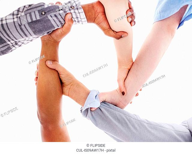 View from below of people holding wrists