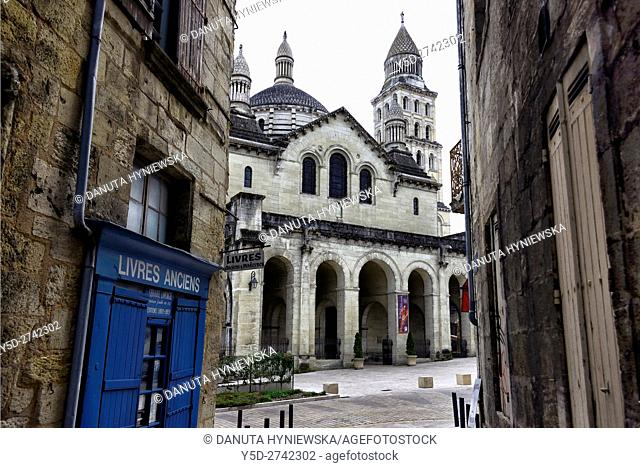street scene, view from narrow street Rue de la Nation to wide Avenue Daumesnil and entrance to Saint-Front Cathedral in background, old town of Périgueux