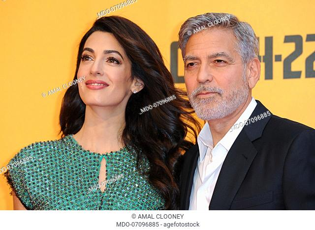 American actor George Clooney and his wife, Lebanese lawyer Amal Clooney attend the premiere of the Sky TV serie Catch-22