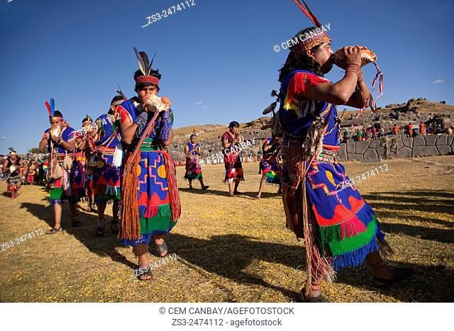 Scene from the Inti Raymi Festival at Saqsaywaman with the performers blowing the conch shells in the foreground, Cuzco, Peru, South America