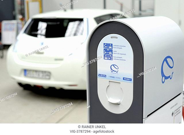 GERMANY, DORTMUND, An electric car Nissan Leaf is charged with electricity at Technical University Dortmund , the picture is showing a charging unit by RWE AG