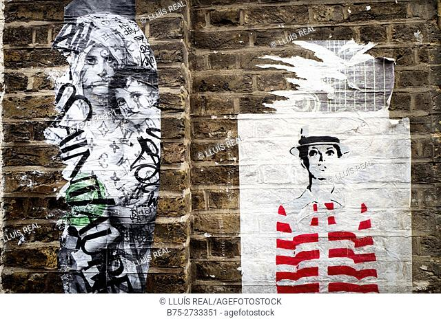 Street art on brick wall. East End, London, England