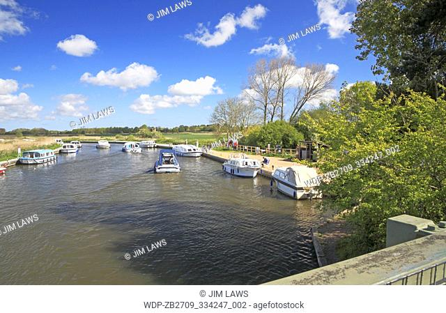 A view of boat traffic on the River Ant on the Norfolk Broads upstream of Ludham Bridge, Norfolk, England, United Kingdom
