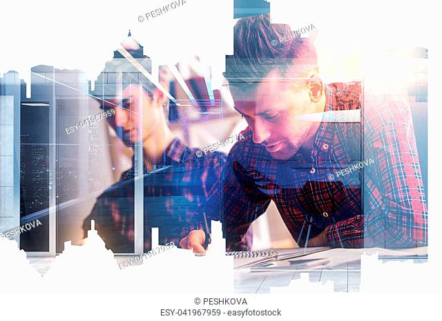 Side view of two handsome businessmen doing paperwork in abstract office with city view. Teamwork and business concept. Double exposure