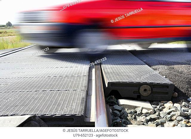 Car crossing rail tracks in a railway crossing without barriers
