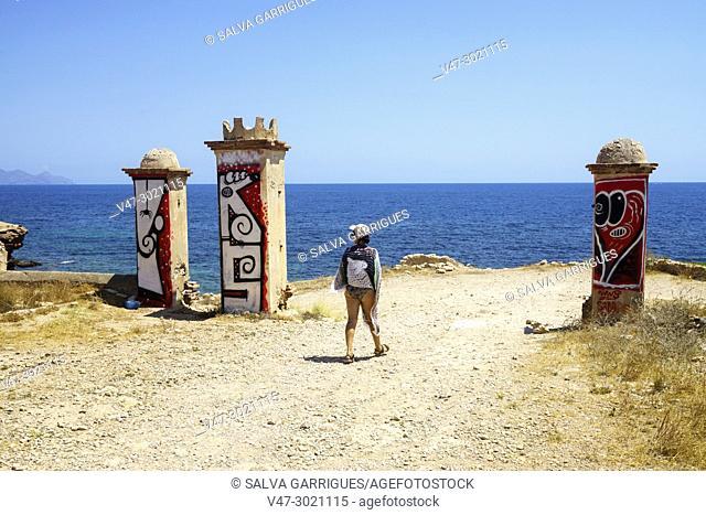 A tourist walking along Percheles beach, virgin beach of Mazarrón, Murcia, Spain, Europe