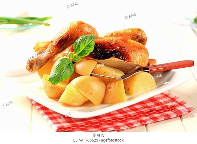 Roast chicken and new potatoes - still life