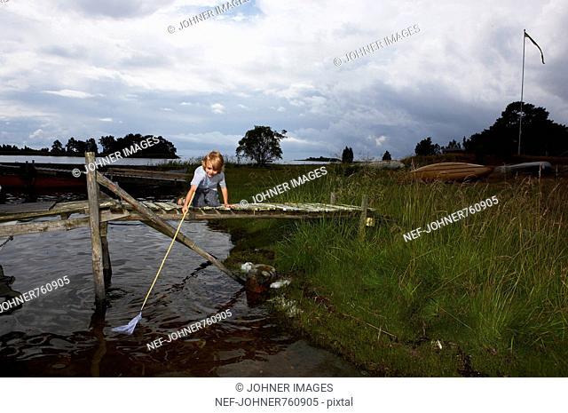 Boy using a bag net, Sweden
