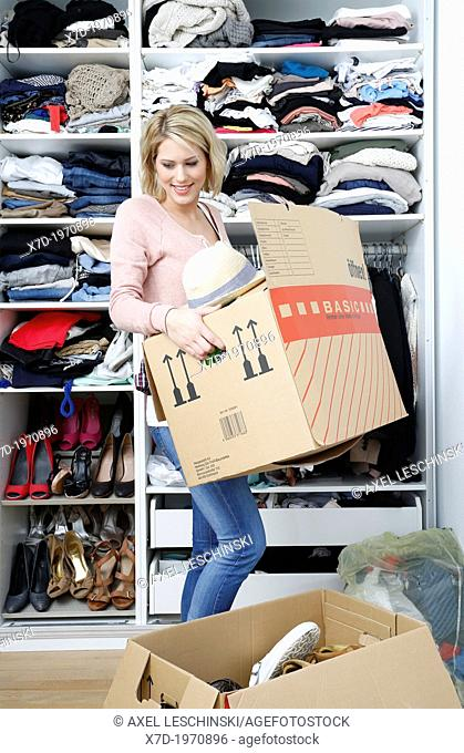 woman clear out her wardrobe