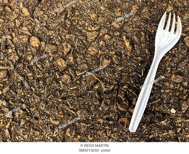 Plastic fork on the ground