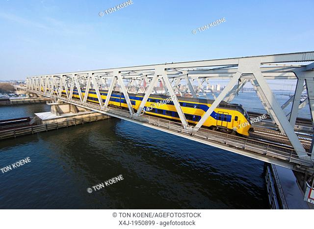 (train) Bridge over the river 'Maas' in dordrecht