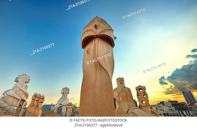 Chimneys and ventilation shafts on the roof of Casa Mila, known as La Pedrera, designed by architect Antoni Gaudi. Barcelona, Catalonia, Spain