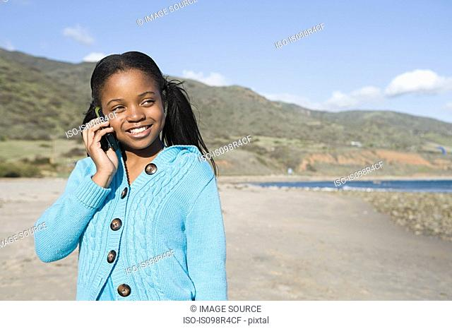 Girl using a cellular telephone