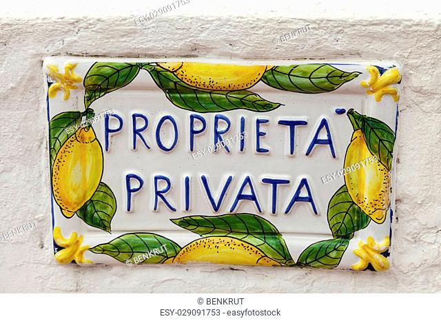 Private property sign on white wall. Amalfi Coast, Campania, Italy