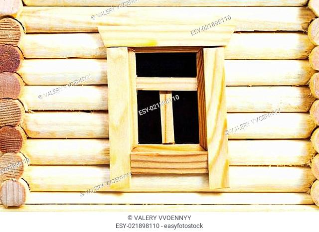wall with window of wooden log house