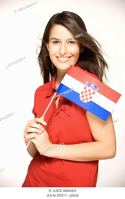 Young woman holding Croatian Flag