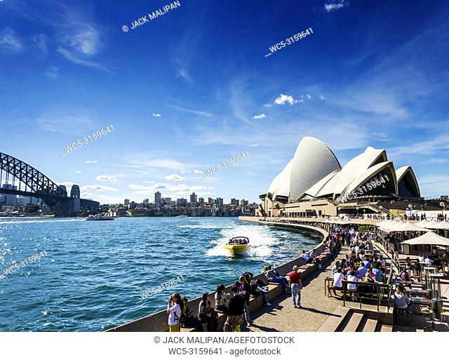 sydney opera house famous landmark and waterside cafe restaurant promenade in australia