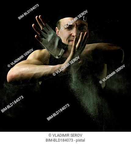 Caucasian man flexing muscles