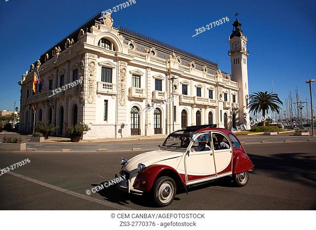 Car in front of the Port Authority Building with it's clock tower, Valencia, Spain, Europe