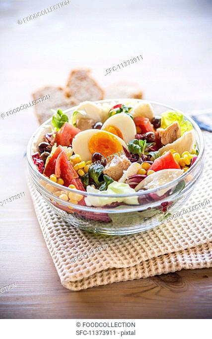 A mixed salad with tuna fish, sweetcorn and hard-boiled egg