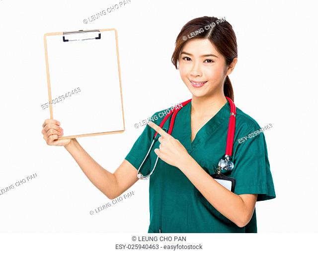 Female doctor finger point to clipboard