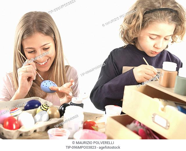 Girls painting Easter eggs