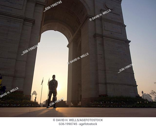 Security guard standing at India Gate in New Delhi, India
