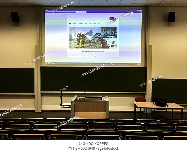 Tilburg, Netherlands. College classroom with viewing screen, displaying a photographers website