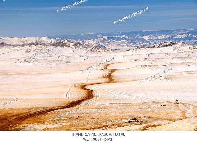 Road through winter landscape, Olkhon island, Lake Baikal, Siberia, Russia, Eurasia