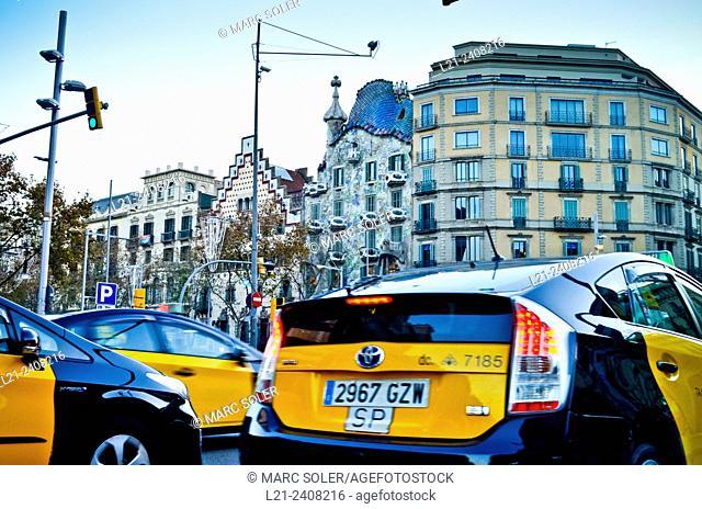 Taxis. At the bottom, Amatller House by Puig i Cadafalch and Batllo House by Antoni Gaudi. Passeig de Gracia, Barcelona, Catalonia, Spain