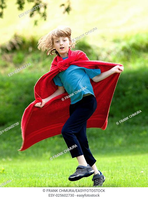 Boy Running Around in Red Towel as Superhero Cloak