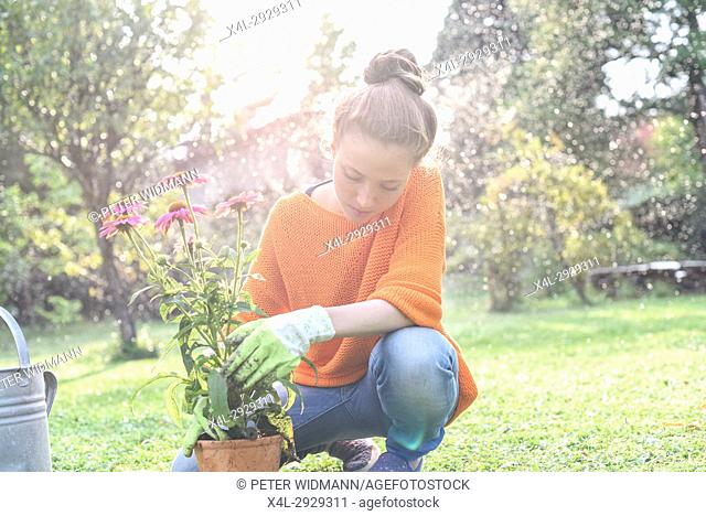 Young woman in her garden, near Vienna, Austria