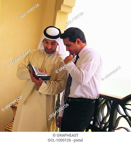 Arab businessmen discussing agenda