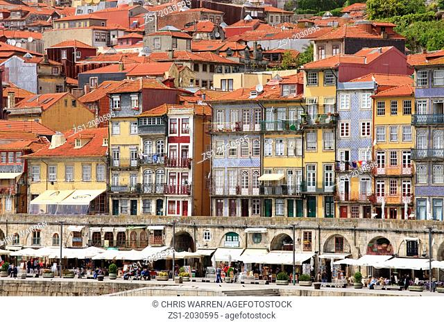 waterfront houses shops and cafes Cais da Ribeira Porto Portugal.	1015