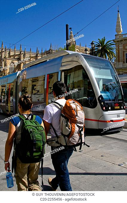 Tourists and tram in front of Cathedral, Sevilla, Andalusia, Spain