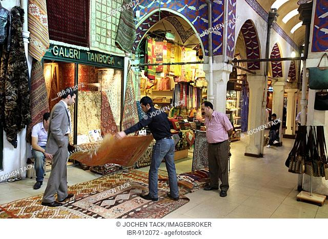 Rug merchant at the Grand Bazaar or Covered Bazaar, covered market consisting of numerous vaults with goods of all sorts, Istanbul, Turkey