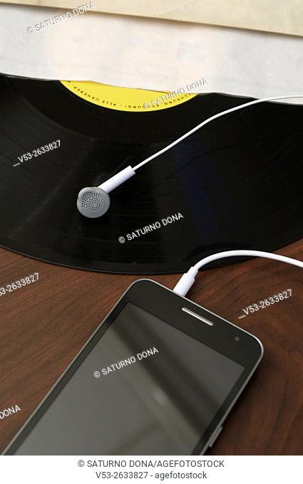 Smartphone earphone on vinyl record