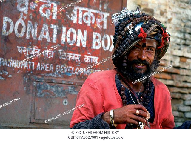Nepal: Sadhu (Holy Man) wearing rudraksha (seeds used for prayer beads in Hinduism) around his neck and as a hat, Pashupatinath, Kathmandu