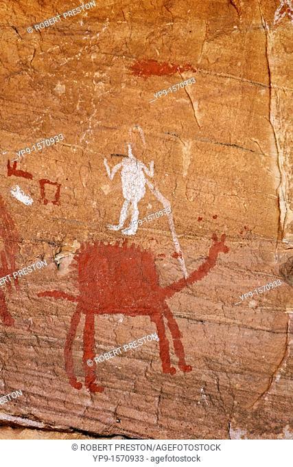 Painted figures and domestic animals, rock art in the Akakus Mountains, Sahara Desert, Libya