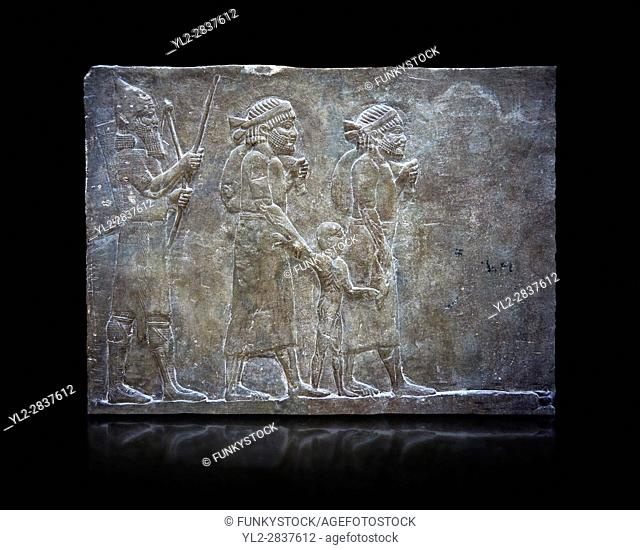 Stone relief sculptured panel of prisoners from the campaign of Elam. From the palace of Ashurnasirpal II room VI/T1, Nineveh, circa 645 BC
