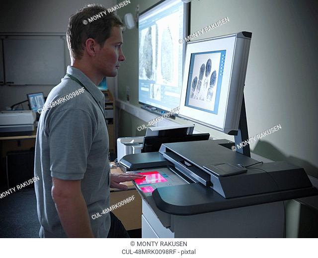 Forensic student taking fingerprints