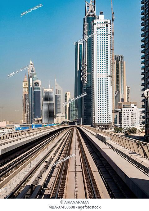 Dubai metro tracks along the skyscrapers in Dubai, United Arab Emirates