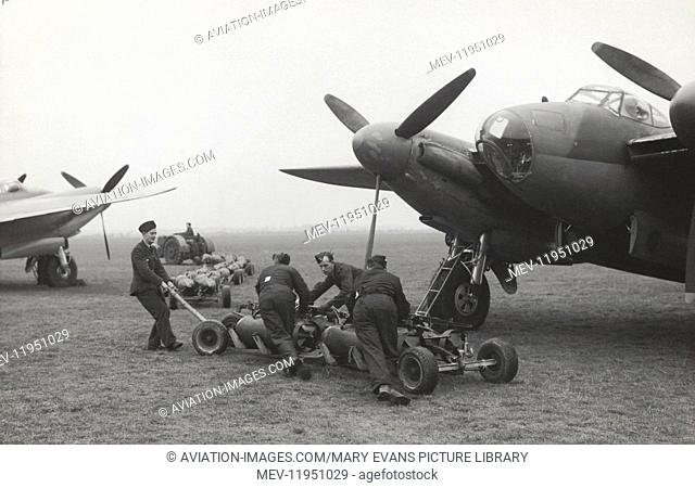 Armourers Pulling a Trolley with Bombs in Front of a Royal Air Force RAF de Havilland Dh-98 Mosquito Parked with Nose of Another Mosquito and Tractor with Bombs...