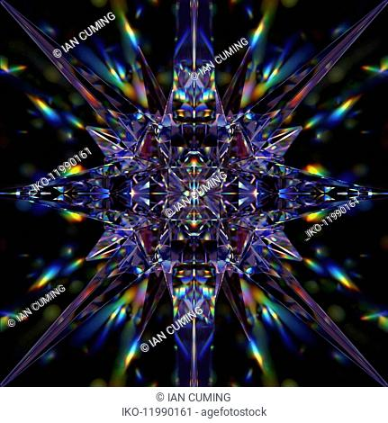 Abstract symmetrical pattern of multicolored light trails and crystal pyramid shapes